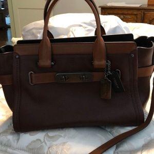 Brown  pebbled leather Coach handbag.